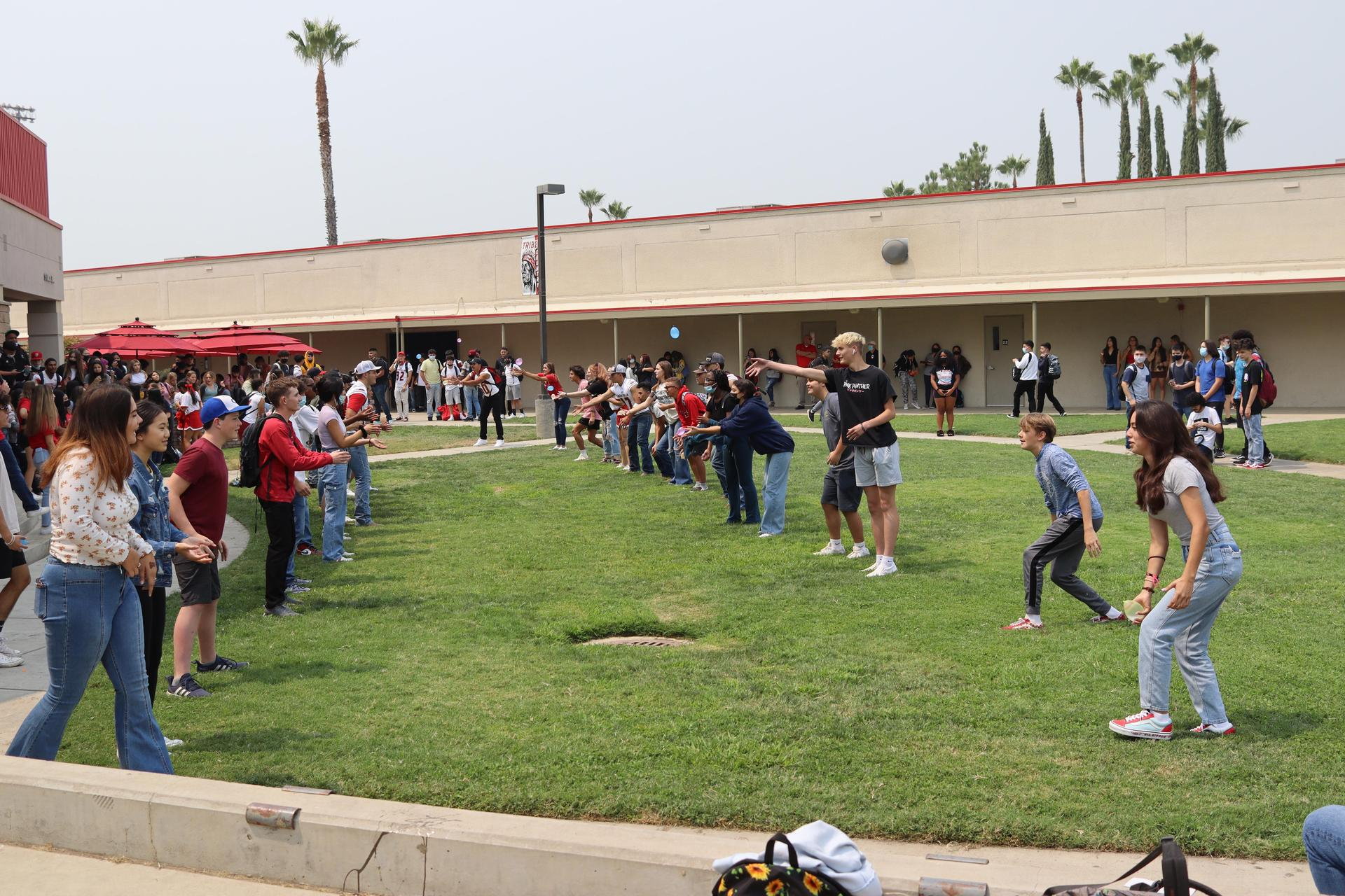 Students tossing balloons at lunch