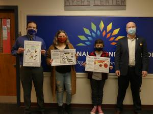 poster contest winners with art teacher and principals
