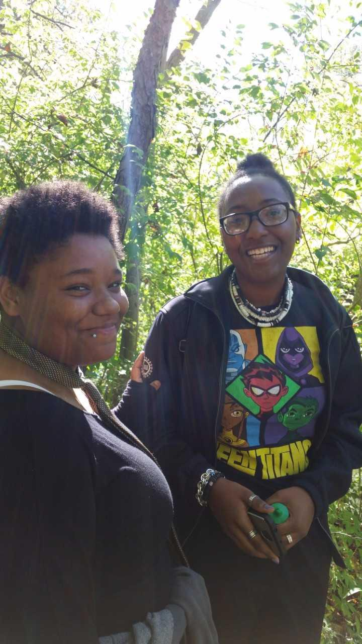 Two smiling, happy students on the nature trail.
