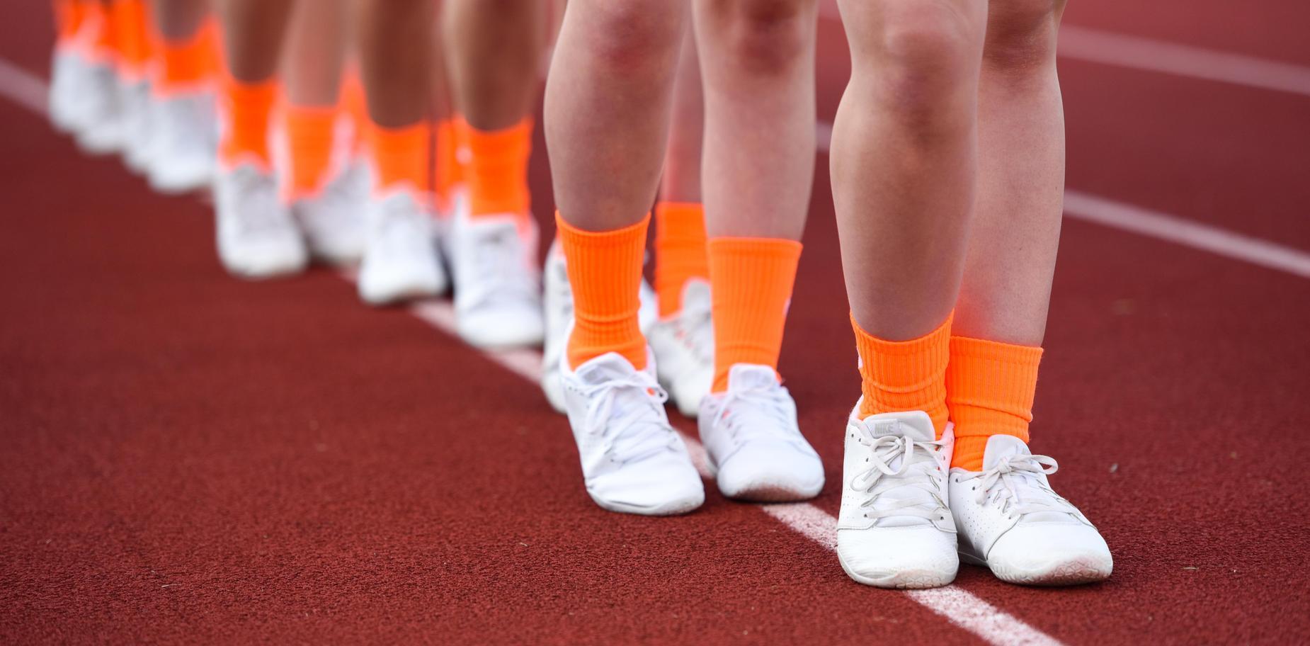 cheer squad in orange socks for Orange Out