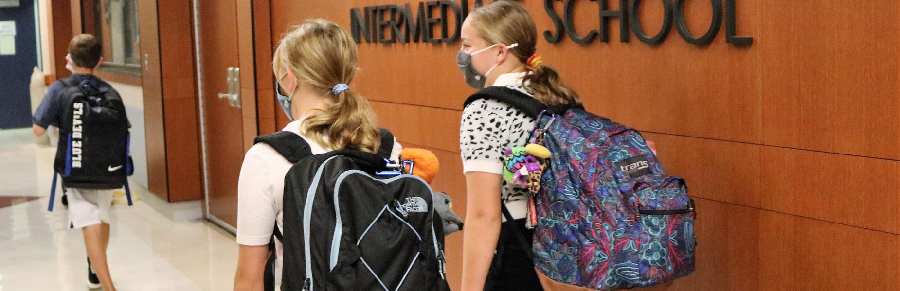 Photo of students walking in hallway on first day of school.