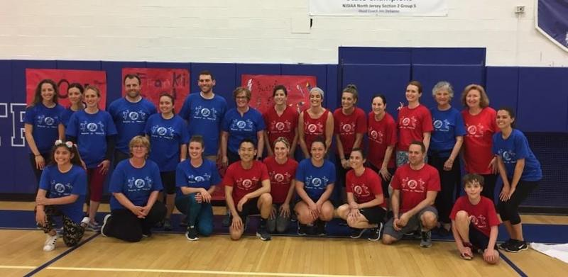 Franklin Elementary School staff members team up on May 29, playing a charity volleyball game to raise money for a scholarship in honor of former student Jake Tooley.