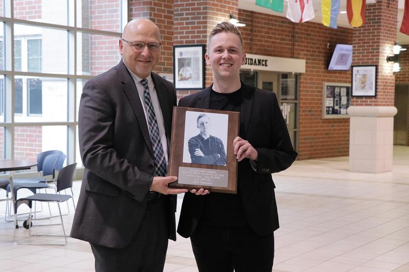 Supt. Haase and AJ Pruis pose for a picture with his plaque.