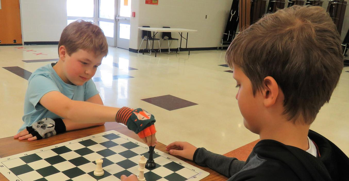 Page students enjoy the after-school chess club.