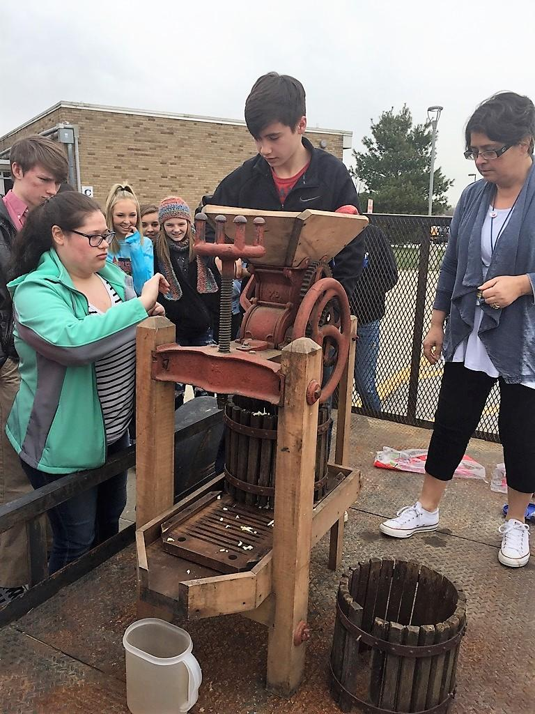 Students look at old time machine.