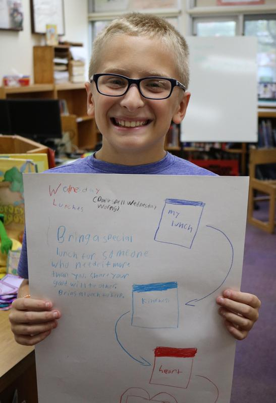 Photo of student member of Jefferson Early Act Club creating posters for Wednesday Lunches initiative.