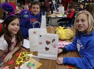 Photo of two Jefferson School students enjoying Valentine's Day activities.