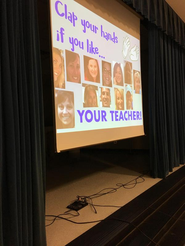 Image of a projected image with teacher photos.
