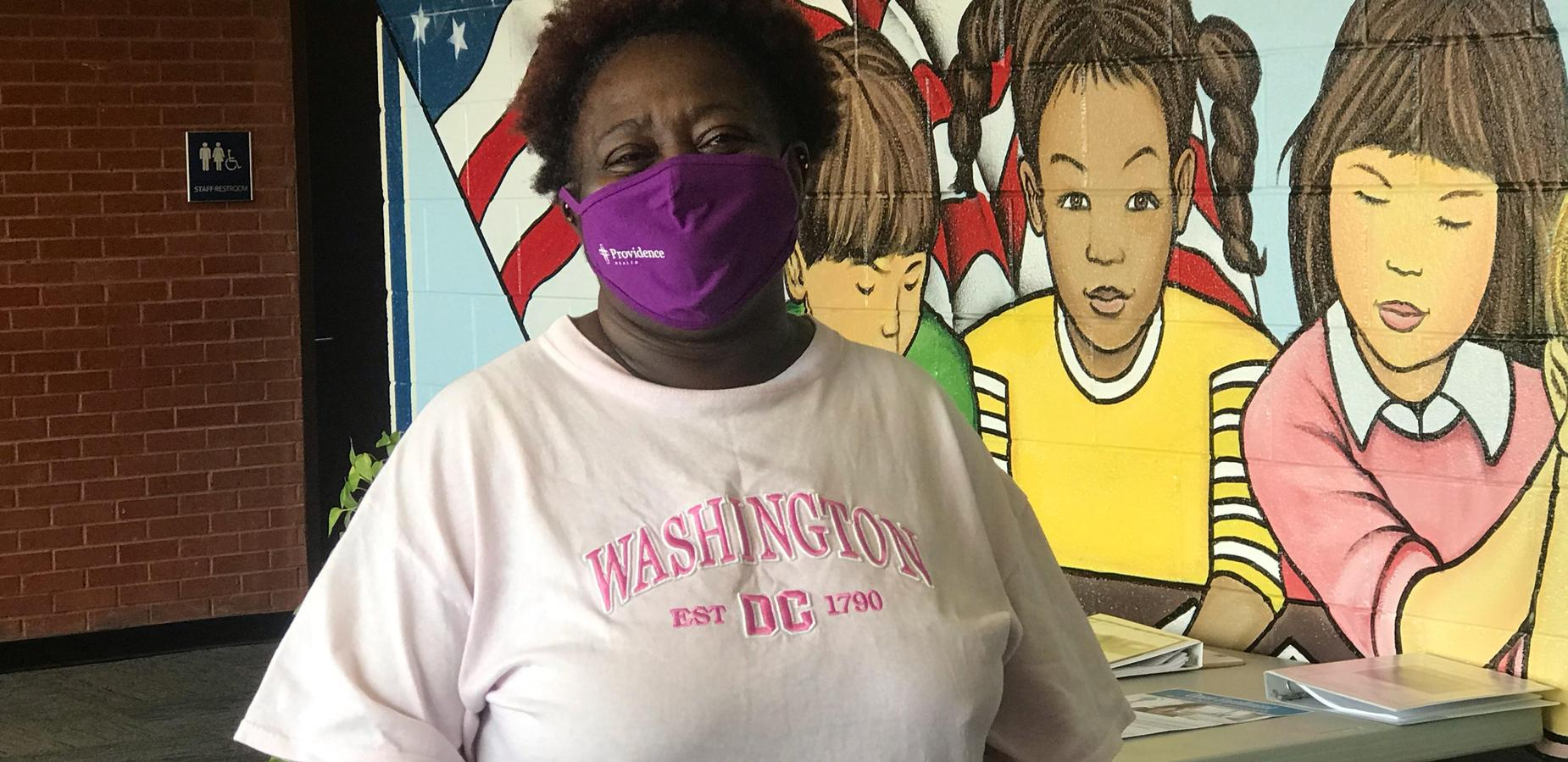 Mrs. Tina wearing her purple Providence mask