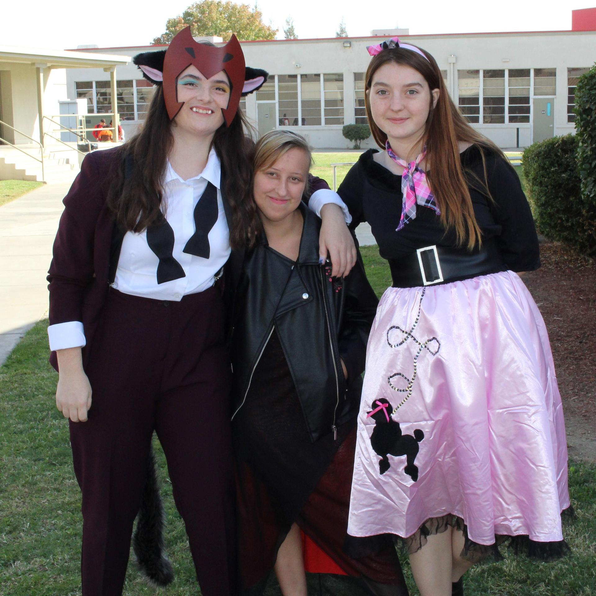 Halle Freitas as a cow, Aleyah Frank as a vampire, Cloie Derring as a pink lady from Grease