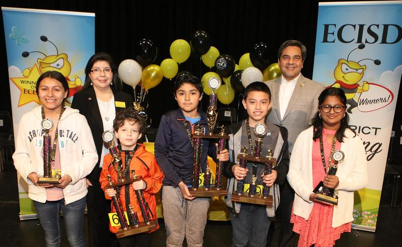 Five Edinburg CISD students advance to Regional Spelling Bee. Pictured L-R: Harwell Middle School student Luz Delgado (fourth-place winner), ECISD Instructional Materials and Library Services Coordinator Dora Estrada, Canterbury Elementary School student Caleb Giuoco (second-place winner), Brewster School student Lorenzo Garcia (first-place winner), Harwell Middle School student Roel Rosa (third-place winner), ECISD Assistant Superintendent for Technology Services Dr. Eddie Moreno and Trevino Elementary School student Amisha Jacob (fifth-place winner).