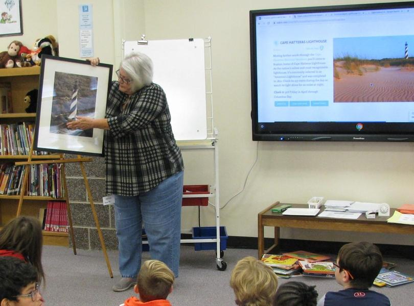 3rd Graders listen to Ms.Sandy share her experience of the Cape Hatteras Lighthouse being moved in 1999.