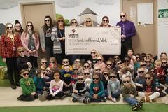 Little Dragon Center receiving generous donation from Financial Plus Credit Union
