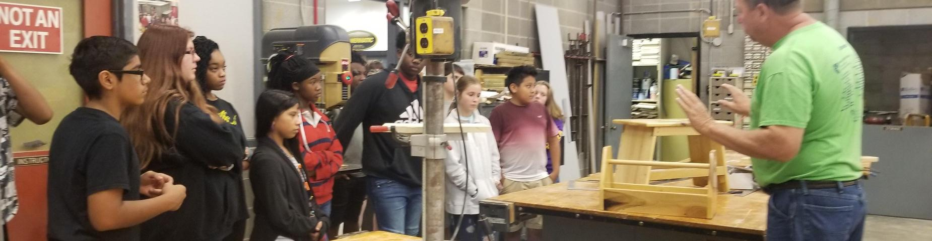 Career Field Trip students learning about wood shop.