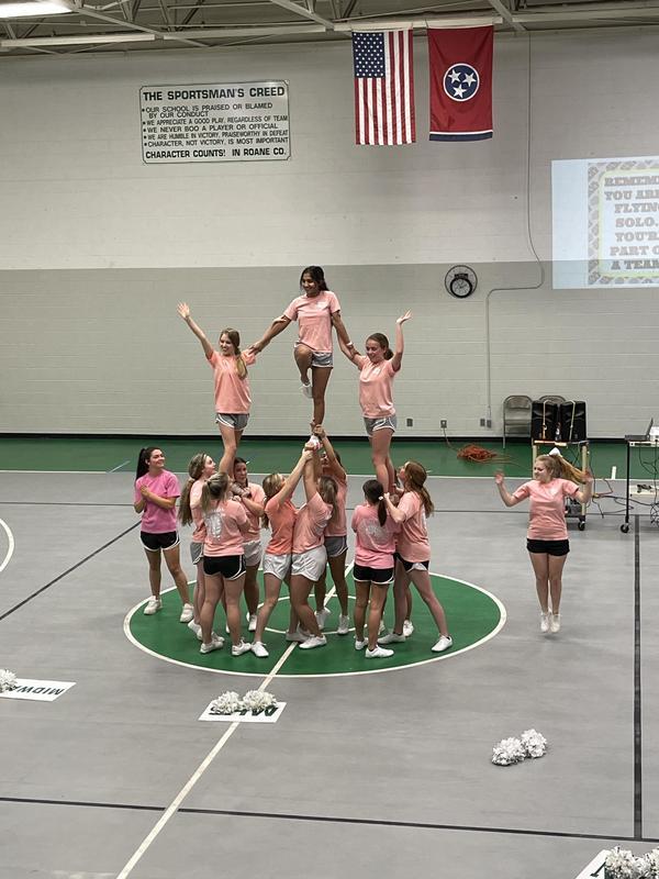 MHS Cheerleaders stunt for MES