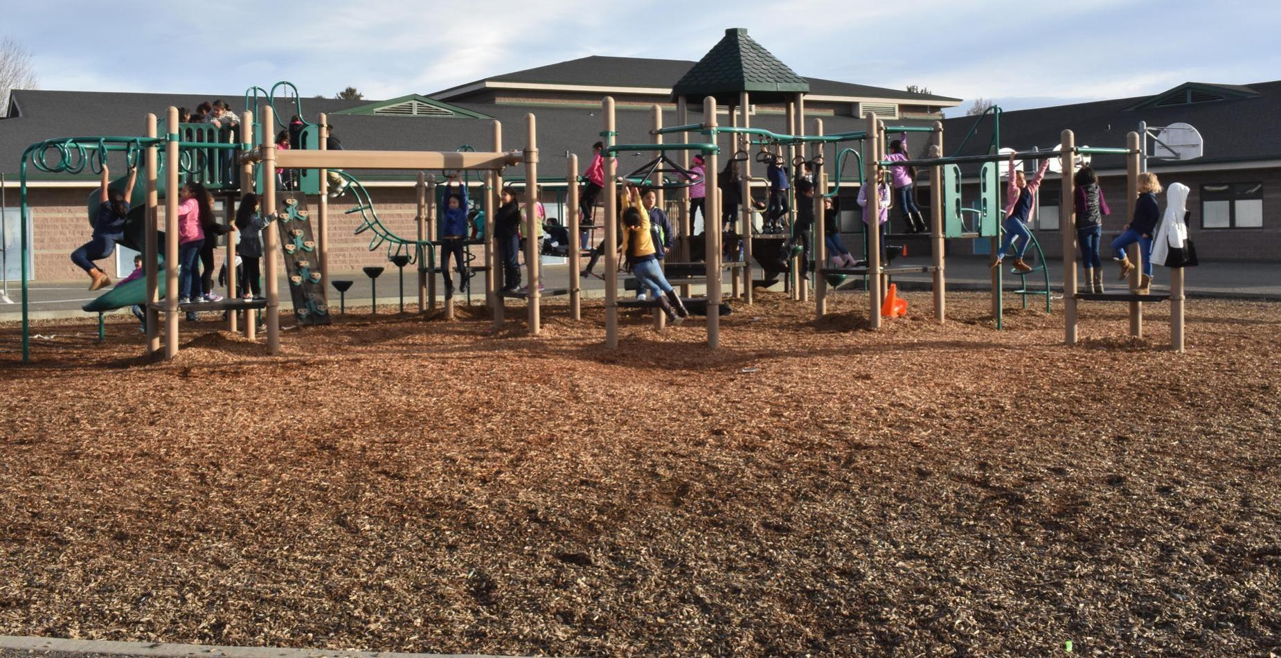 Students playing on playground equipment