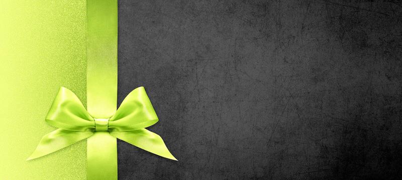 A light green bow on green and dark brown