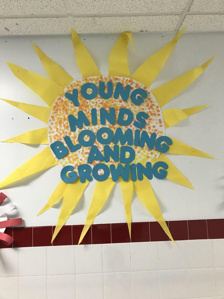 young minds blooming and growing large yellow sun