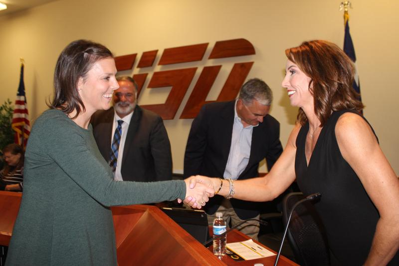 New CFO Sarah Taylor congratulated by CISD board member