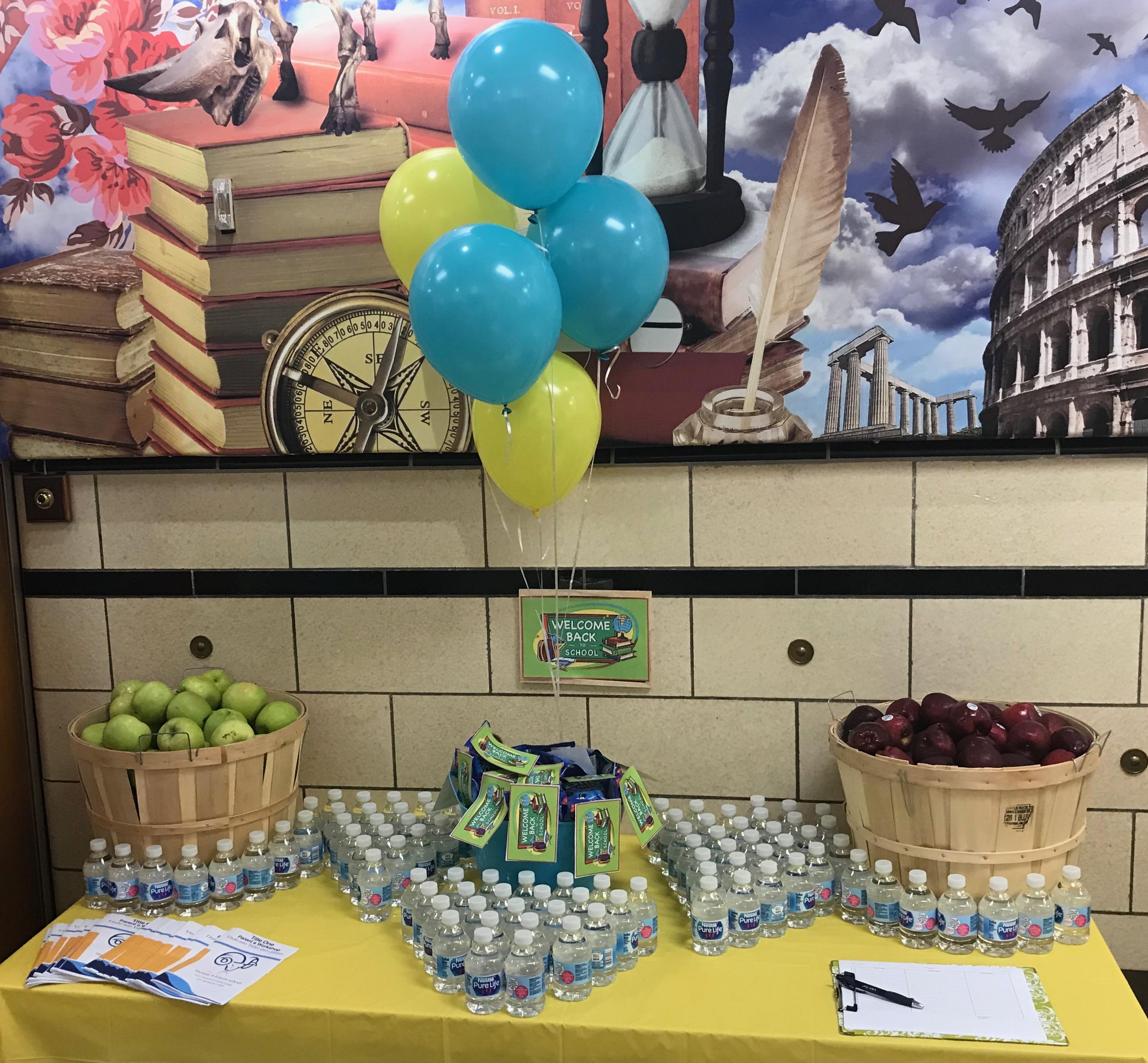 healthy snack of apples, water, & granola bars for back to school night