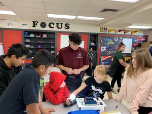 Independence High School student helps Lakeside students with science project.