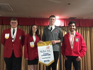 Students accepting Gold Level status for the State SkillsUSA Conference.