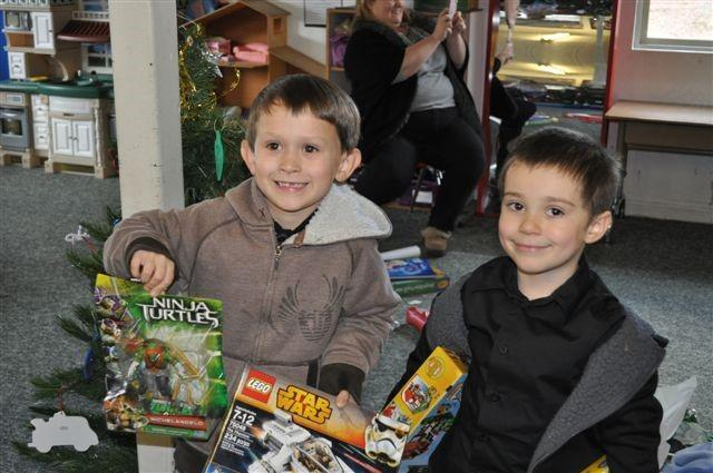 children and their gifts from santa