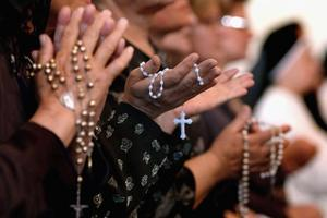 praying rosary.jpg