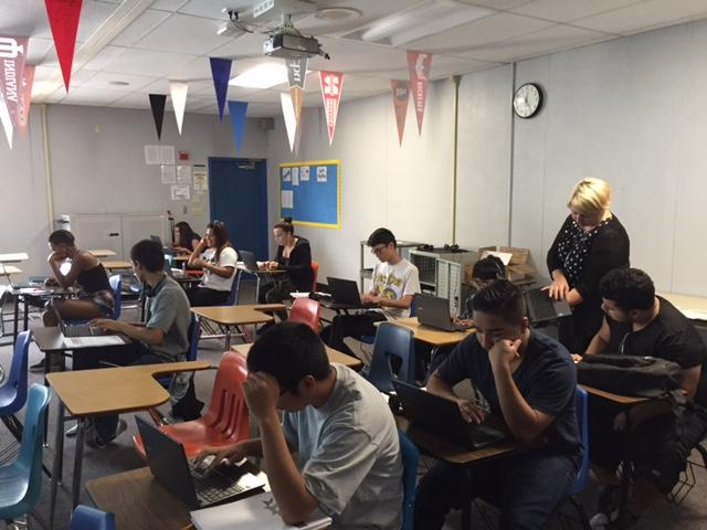 Students engaged in class and in their chromebook