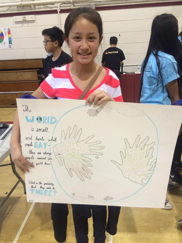 Marguerita student presents her finished poster board.