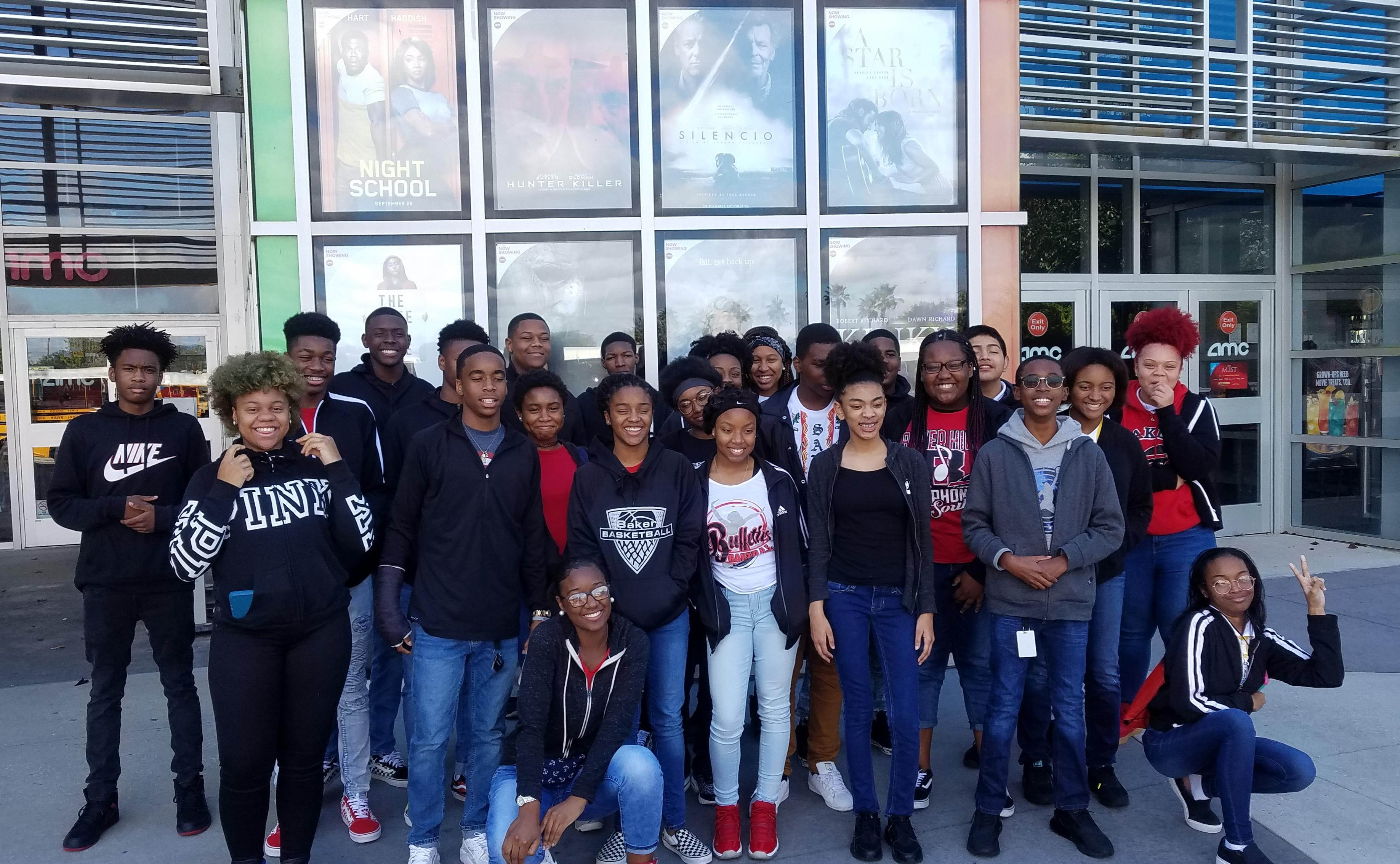 a group photo of Baker High 9th graders in front of AMC Theaters on school field trip to see movie