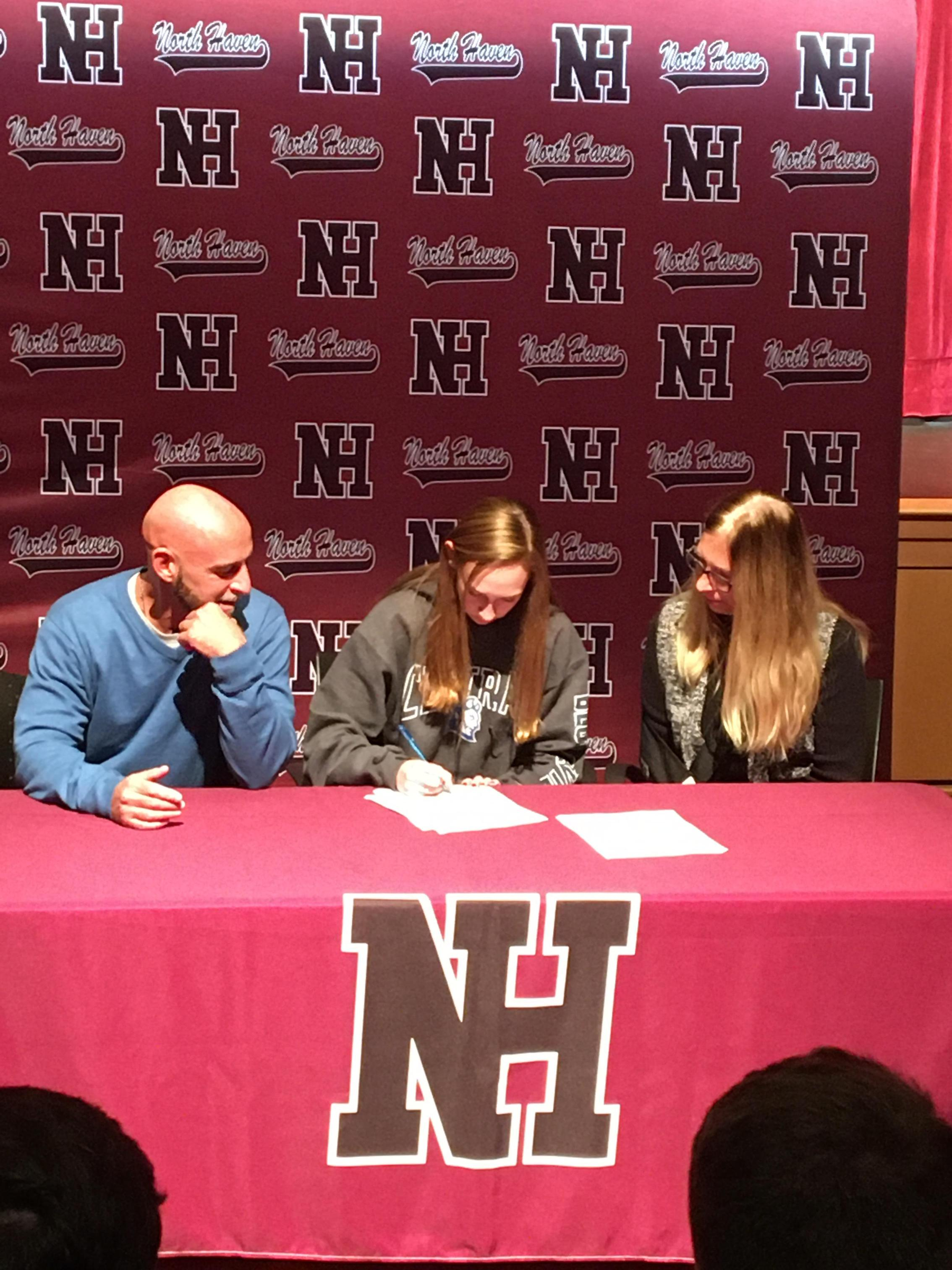 Ava Santacroce signs her NLI.