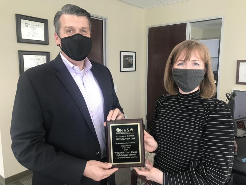 Superintendent Mike Kuhlman and Clinical Coordinator Stephanie Cotcher hold the NASW Award for State Organization of the Year presented to the Hart School District
