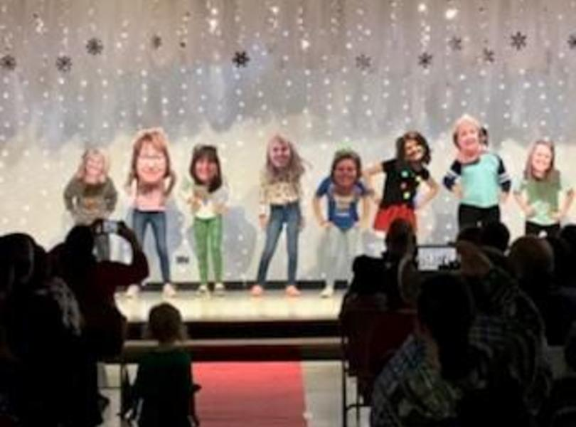 Students wearing Bobbleheads at Talent Show.