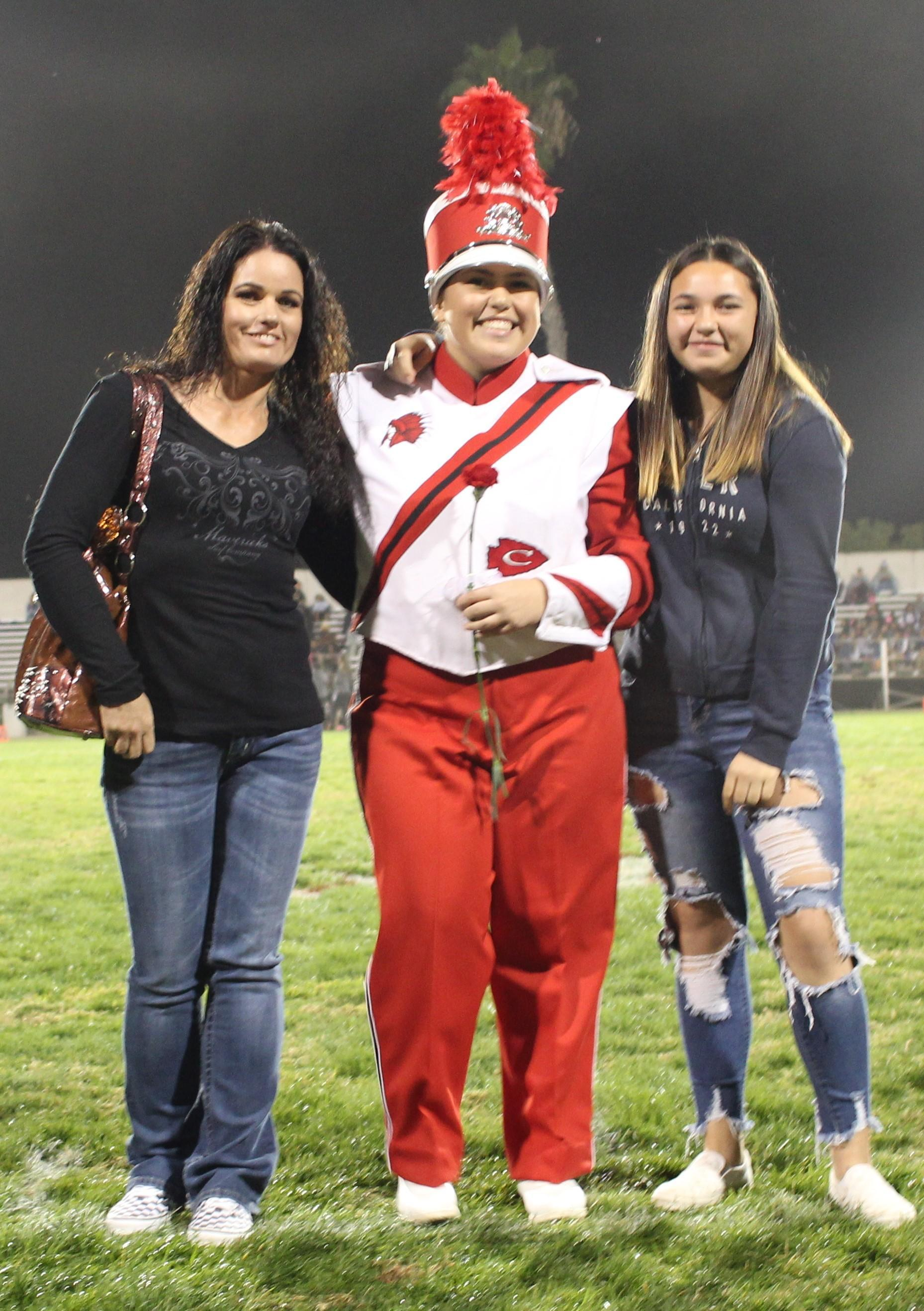 Senior band member Brooke Luna and her escorts.