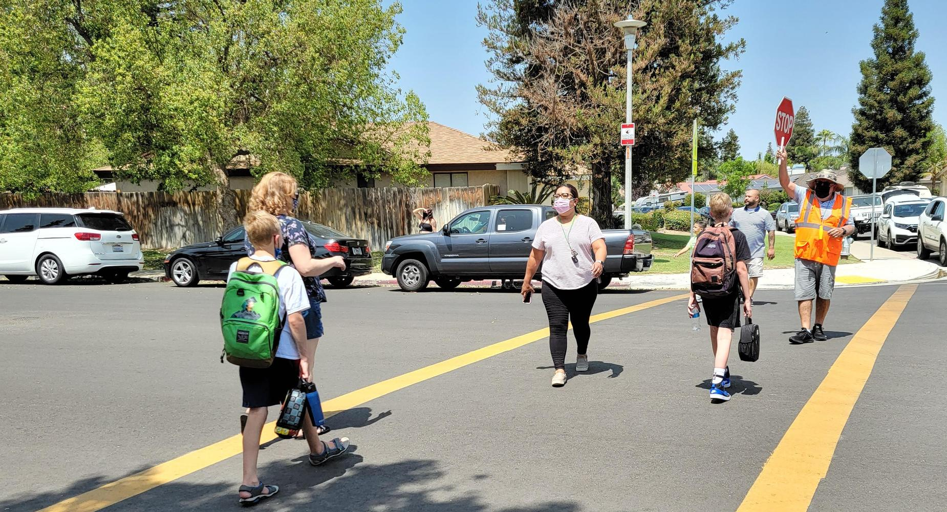 Crossing guard keeping kids safe on their walk to and from school