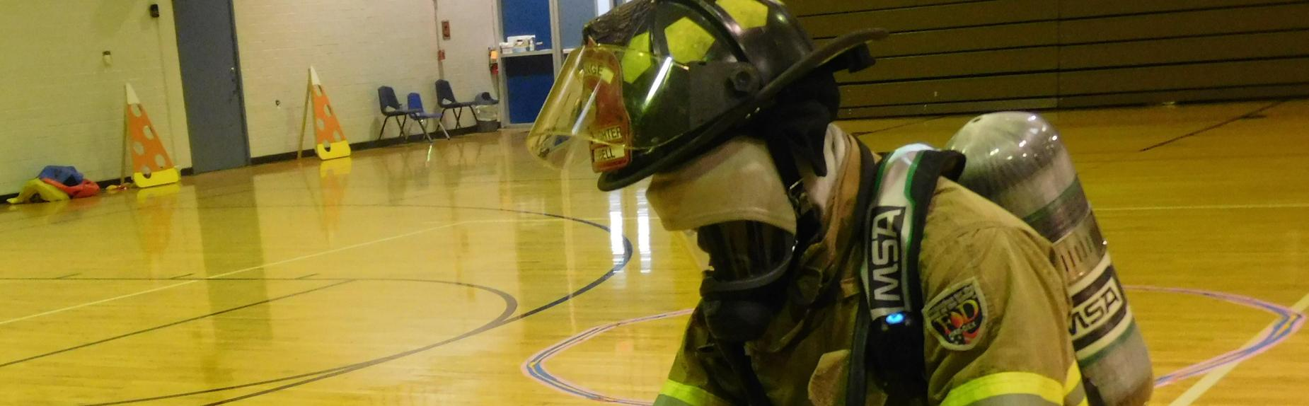 Firefighter dresses up for North students