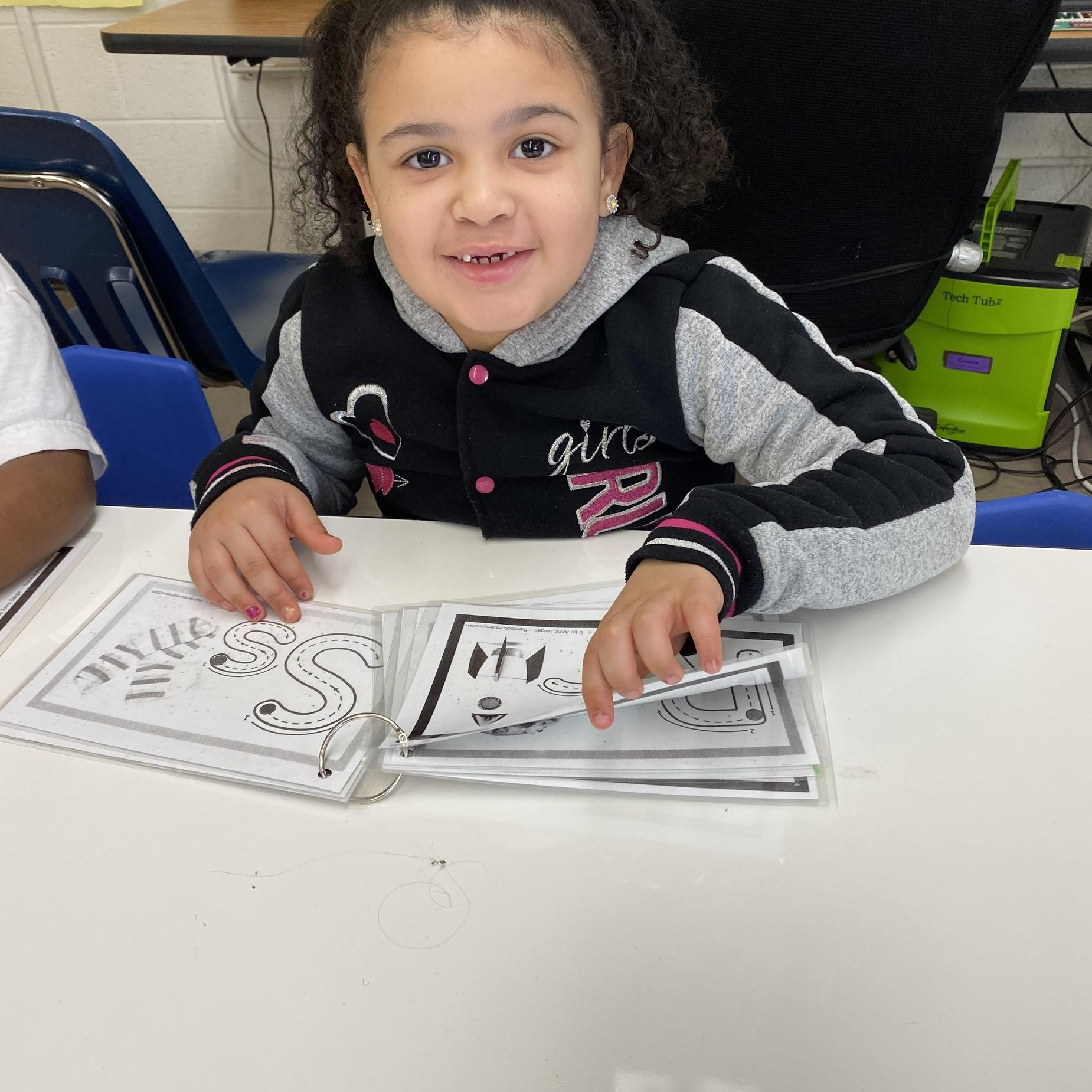 Another student practicing letters.