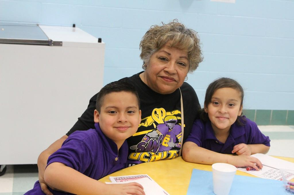 Students enjoying time with grandparents.