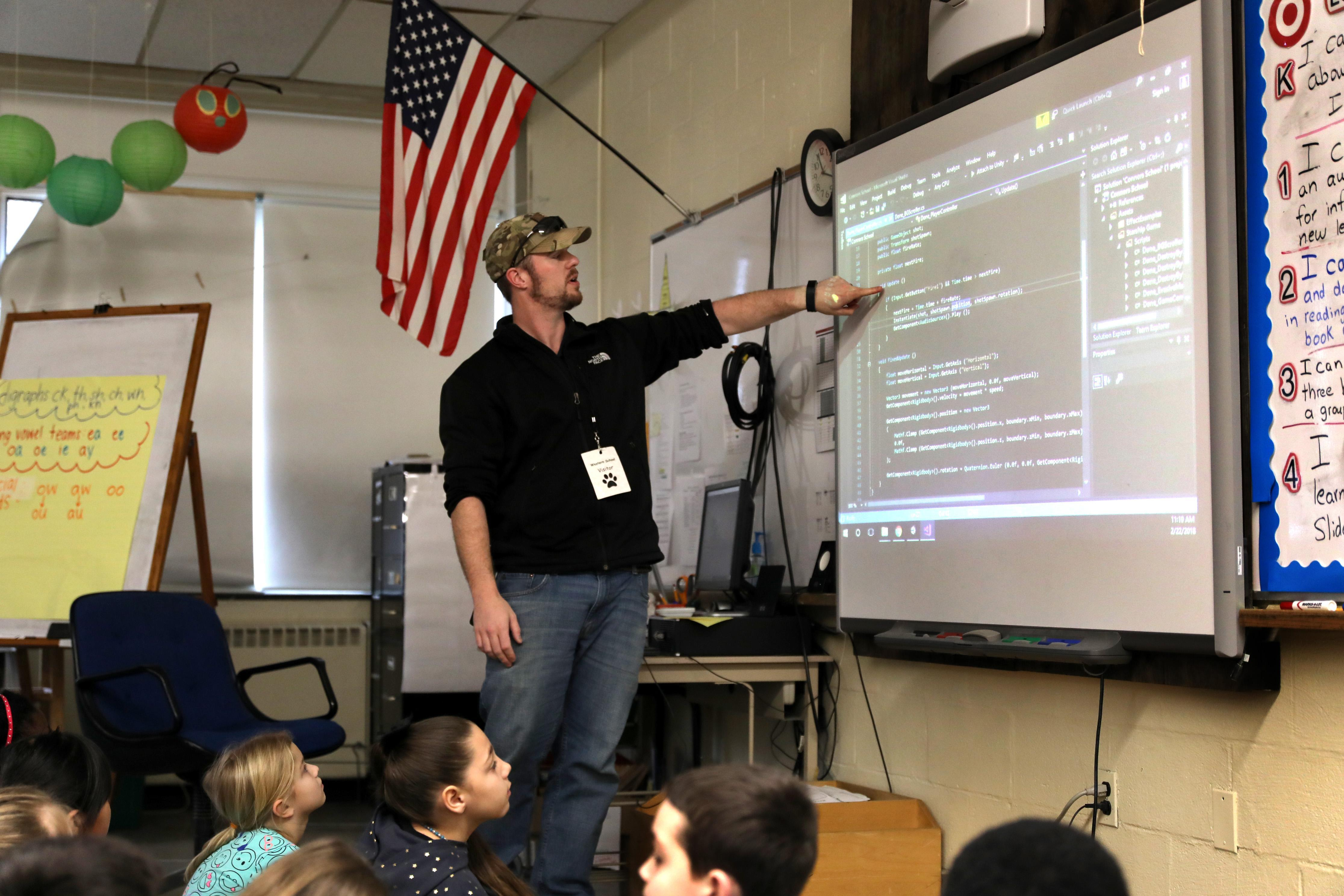 Parent teaching class about his career in game design