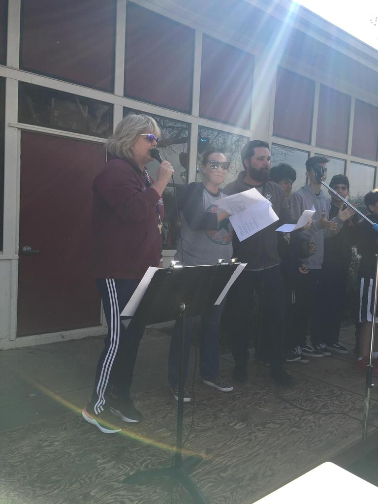 teachers singing at assembly