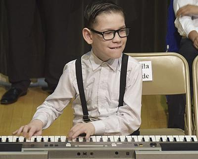 Young student playing the keyboard.