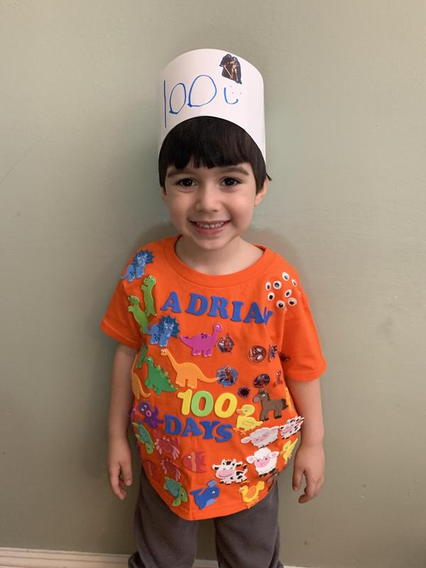 Adrian wearing orange 100 day shirt