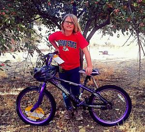 Perfect Attendance winner showing off her bike