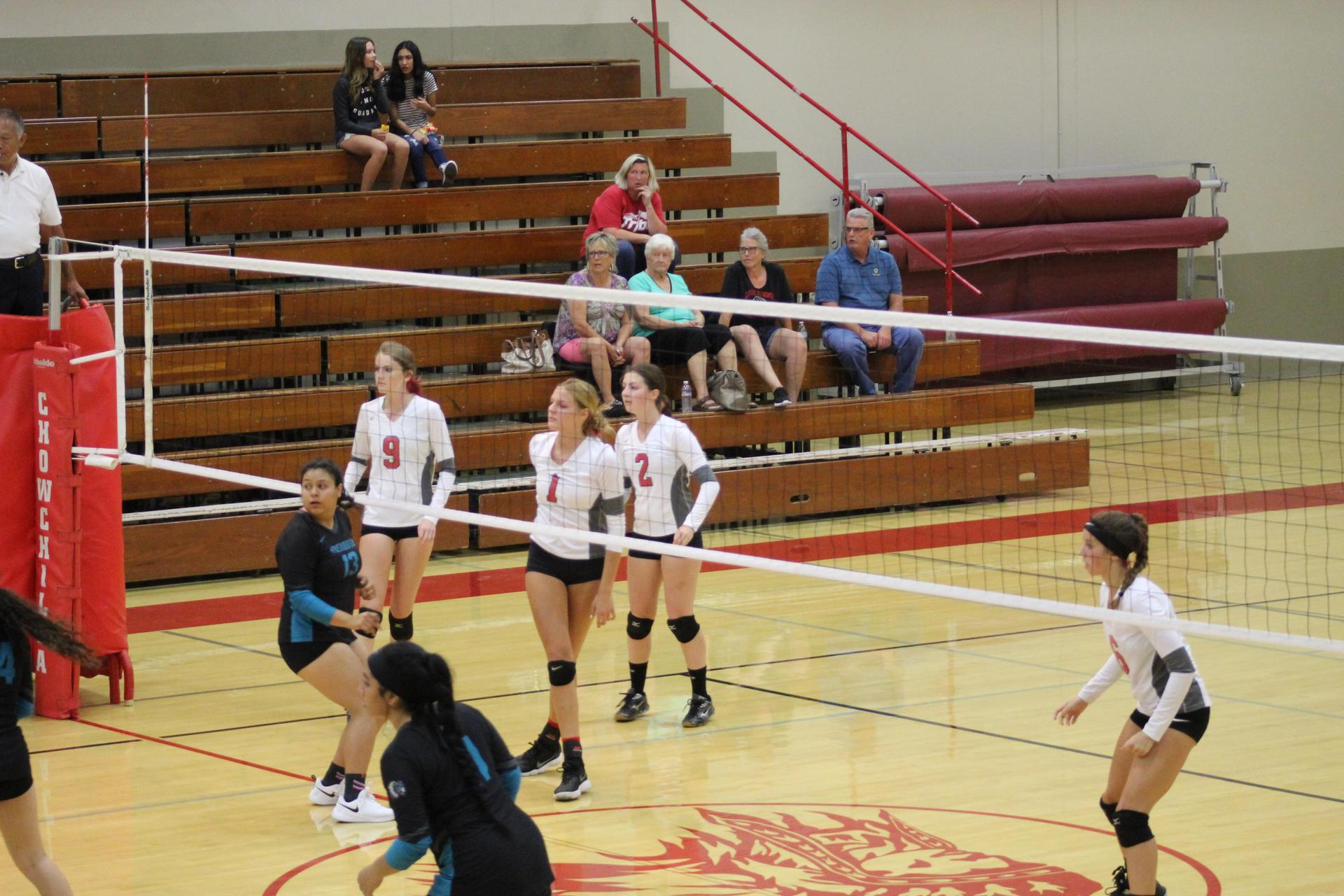 Girls playing volleyball vs Mendota