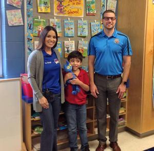third grade student with principal Montemayor and curriculum assistant Ms. Vega