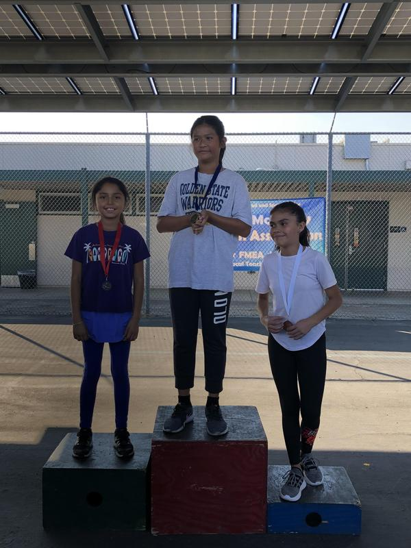 A Lairon student on the podium at the FMEA Track Meet