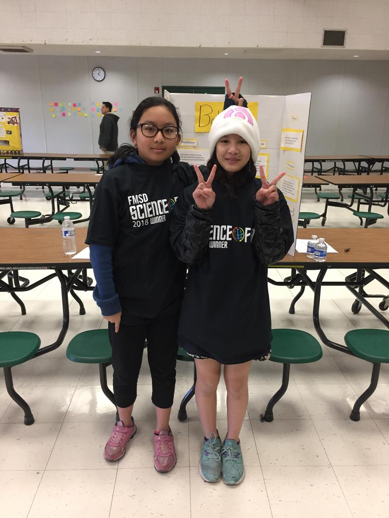 second place winners pose for a picture with their FMSD science fair shirts