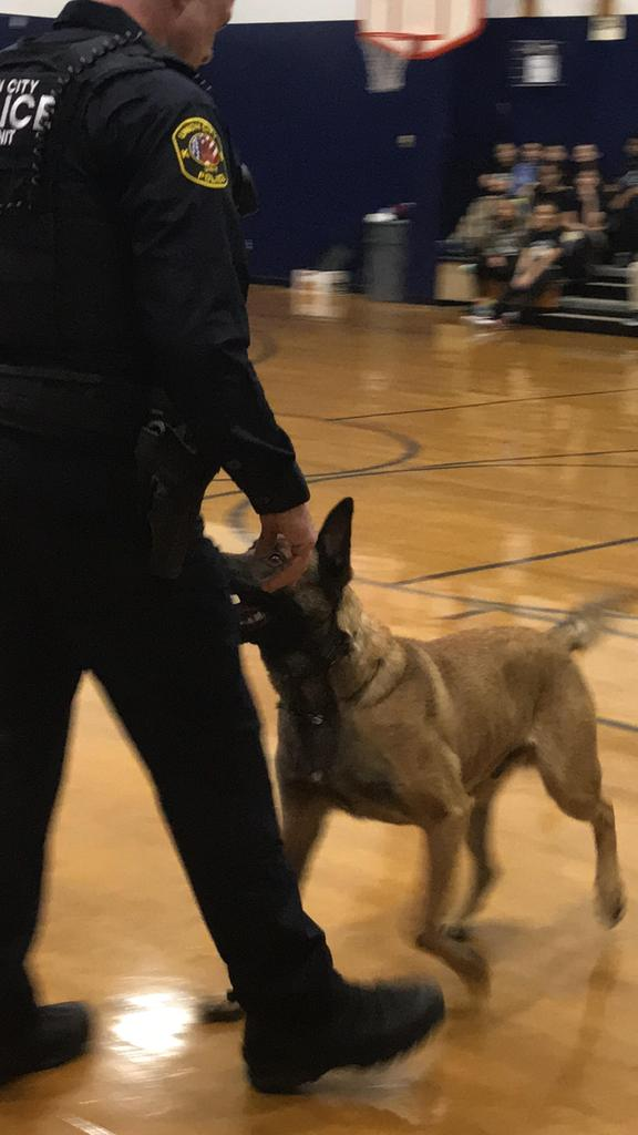 dog in front of the officer responding for a command
