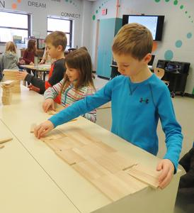 Lee students use a variety of methods to count 100 Keva Planks.